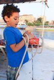 Child on Sailboat in the Nile river Stock Photos
