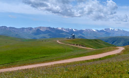 Asy Plateau and Observatory. Asy Plateau and the road to the High-altitude Observatory at the background of Tien-Shan Mountains. Kazakhstan Royalty Free Stock Image