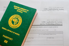 Asylum. Nigerian Passport on Asylum application form stock photography