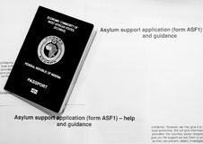 Asylum. Nigerian Passport on Asylum application form royalty free stock photography