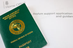 Asylum. Nigerian Passport on Asylum application form stock image