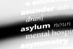 Asylum. Word in a dictionary.  concept royalty free stock photos