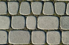 Asymmetric paving slabs of gray color, different size. Background stock images