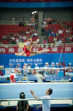 Asymmetrical bars-Chinese gymnastics competition in the Seventh National City Games Stock Photo