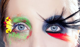 Asymmetrical fantasy eyes makeup spring black bird Stock Photo