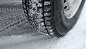 Traces of tread blocks on winter tires under off road vehicle Royalty Free Stock Photo