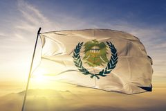 Asyut Governorate of Egypt flag textile cloth fabric waving on the top sunrise mist fog. Beautiful royalty free stock images