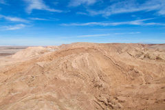 Atacama desert arid flat land an mountains. Atacama desert arid flat land with salty soil, Chile Royalty Free Stock Photo