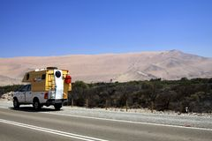 ATACAMA DESERT, CHILE - DECEMBER 19. 2011: 4 wheel camper on highway stock photo