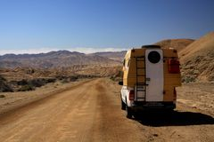 ATACAMA DESERT, CHILE - DECEMBER 19. 2011: 4 wheel camperlost in endless barren landscape royalty free stock images
