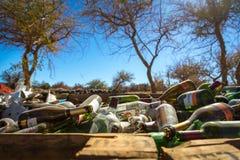 Atacama Desert, Chile - June 4th 2013 - A big pile of glass bottle waiting to be recycled in the Atacama Desert Stock Photos