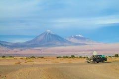 Atacama desert jeep tour. Dry desert in Atacama, Chile. Arid flat land. Atacama desert jeep tour under the volcano Royalty Free Stock Images