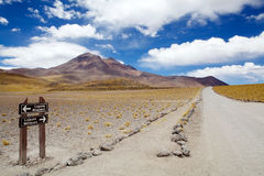 Atacama desert landscape, Chile. The footpath from the Miscanti lagoon to Miniques lagoon with volcano in the background in the Atacama desert, Chile. Miscanti Royalty Free Stock Photography