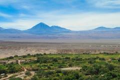 Atacama desert landscape. Atacama desert volcano and green city landscape Royalty Free Stock Photography