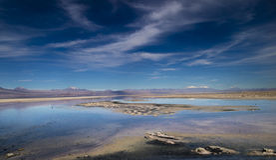 Atacama Vista. Blue skies overa salt lagoon in the Atacama Desert Stock Image