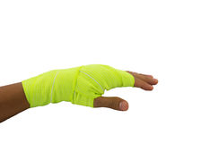 Atadura elástica amarela amarrada mão Imagens de Stock