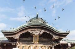 Atago Shrine. Detail of the Atago Shrine Roof with birds flying over.  Fukuoka Japan Stock Photo