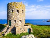 Atalaya antigua en la isla de Guernesey Fotos de archivo libres de regalías