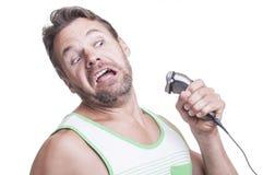 Ataque de la maquinilla de afeitar eléctrica Imagen de archivo libre de regalías
