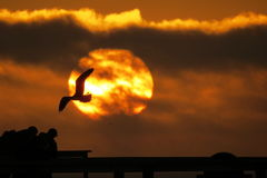 Pismo Beach Sunset. Orange sunset at Pismo Beach Pier California Stock Photo