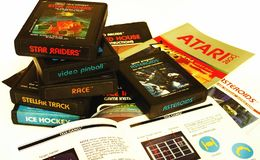 Atari 2600 video games. Video games and manuals from circa 1981. Vintage electronics and gaming. Against a white background stock photography