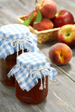Atasco, melocotones y manzanas Fotografía de archivo