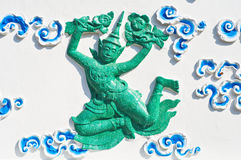 Atatues of green angel. Ancient statues of green angels in Wat Sutuch ,Bangkok Thailand stock photography