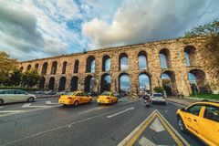 Ataturk Boulevard and Ancient roman Aqueduct of Valens in Istanbul. ISTANBUL, TURKEY - October 13, 2018: Ataturk Boulevard and Ancient roman Aqueduct of Valens stock photography