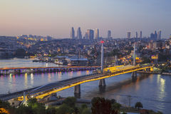 Ataturk bridge, metro bridge and golden horn at night - Istanbul, Royalty Free Stock Photo