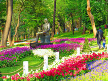 Ataturk Monument among blooming tulips at the entrance to Gulhane Park Royalty Free Stock Image
