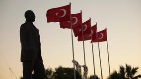 Ataturk statue and Turkish flags waving at Izmir. Karsiyaka - Turkey stock footage