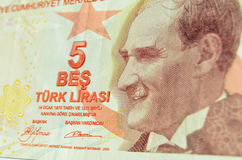 Ataturk on Turkish banknote. Angled view of a used five Lira banknote from Turkey.  Includes smiling image of  President Mustafa Kemal Atatürk (1881-1938 Stock Image
