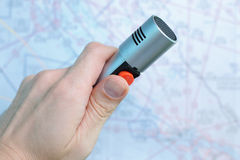 ATC microphone. Hand holding air traffic control microphone with aeronautical chart in background Stock Images