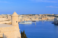 Atchtower and fort St. Angelo in Grand Harbour of Valletta Royalty Free Stock Images