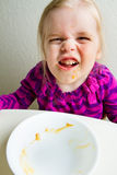 She ate it all. Young kid ate all the food in her bowl royalty free stock images