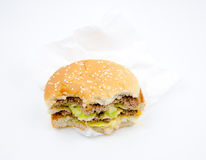 Ate a half of the hamburger on white background royalty free stock photos