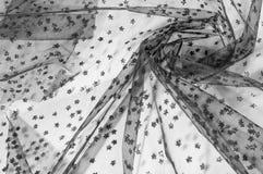 Ate la tela Cordón negro pequeño en el fondo blanco Añada un sutil Fotografía de archivo