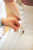 Ate para arriba el vestido de boda Imagen de archivo