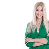Atelieraufnahme der blonden jungen Frau mit den Armen kreuzte lokalisiert auf w Lizenzfreies Stockfoto