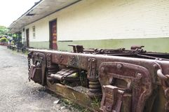 Rusty railway undercarriage outside the Rio Grande Railway Museum. The Atenas Railway Museum is located in the little town Río Grande, next to the railway Stock Image