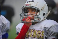 Atención de la paga del fútbol americano de la juventud Fotografía de archivo