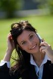 atendimento de telefone da mulher de negócios Fotografia de Stock Royalty Free