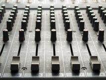 Atenuadores y botones de mezcla del escritorio Foto de archivo libre de regalías