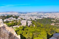 Ateny linia horyzontu z wzgórzem boginki i kościelny Agia Marina, Zdjęcie Stock