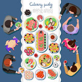 Сatering party with people and a table of dishes Stock Image