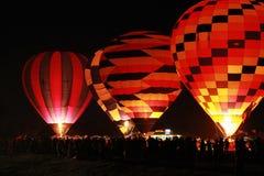 Aterragem do balão de ar quente da silhueta Foto de Stock