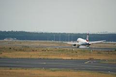 Aterrissagem de Austrian Airlines Airbus A320 Fotografia de Stock