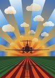 Aterrizaje de aeroplano en la puesta del sol Foto de archivo libre de regalías