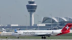 Aterrizaje suizo del avión de la línea aérea en el aeropuerto MUC de Munich