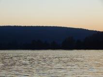 Ath de la puesta del sol el Donau Foto de archivo libre de regalías